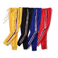 sudor al por mayor-Pantalones de moda para hombre Pantalones de chándal de diseñador de calidad superior Marca Jogger Ropa de la raya lateral Pantalones de cordón de los hombres Pantalones de deporte de la marca