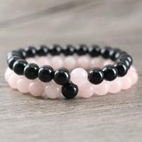 echte kristallarmbänder großhandel-Echte schwarze Onyx Rock Stone Perlen mit natürlichen Rose Pink Crystal Perlen Heilung glückliche Energie Armbänder Paare Armreif Schmuck