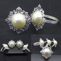 servilleta caliente al por mayor-Hot hot silver pearl hotel suministros de gama alta restaurante servilleta mesa servilleta anillo hierro servilleta anillo T4H0271