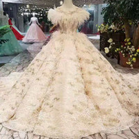Wholesale ostrich feathers wedding dresses resale online - Ball Gown Wedding Dress Champagne O Neck Sleeveless Lace Appliques Beauty Wedding Gown With Ostrich Feathers Wedding Party