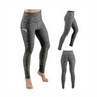 pantalones ajustados de talle alto al por mayor-Venta al por mayor 50 piezas de pantalones de yoga con bolsillos para mujer Medias de gimnasia de cintura alta sólidas Correr elástico Bolsillos de yoga largos elásticos tamaño EE. UU. S-XL