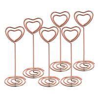 titular de la tarjeta en forma de corazón al por mayor-2 colores en forma de corazón de oro rosa Soporte para fotos Soportes de mesa Número de tarjetas de lugar Tarjeta de papel Clips para la decoración del banquete de boda