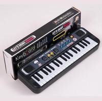 teclados de plastico piano al por mayor-Multifuncional Mini Piano Electrónico con Micrófono Plástico ABS Niños Portátil 37 Teclas Música Digital Electone Teclado de Regalo