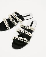 boncuk sandaletleri toptan satış-2018 yaz plaj elbiseleri ayakkabı inci boncuk sandalet ince kemer roma düz kadınlar çevirme rahat terlik moda