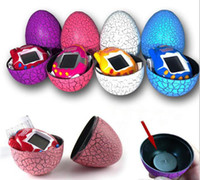 juegos gratis de mascotas al por mayor-Tamagotchi Tumbler Toy Perfect For Children Regalo de cumpleaños Dinosaur Egg Virtual Pets en un llavero Digital Pet Electronic Game DHL Free