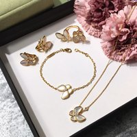 Wholesale asian indian earrings for sale - Group buy Brand silver four leaf flower jewelry set for women wedding necklace bracelet earrings ring Butterfly clover mother shell CZ jewelry