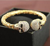 ingrosso donne del braccialetto del polsino del rhinestone-Braccialetto di design di marca di cranio di moda femminile in lega di strass oro / braccialetti di polsino di fascino placcato argento per le donne pulseira feminina