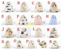 ingrosso piccoli sacchetti di souvenir di gioielli-50pcs / lot liberano il trasporto 10 * 14cm sacchetto del regalo dei monili di cerimonia nuziale cotone stampato borsa con coulisse shopping bags piccolo sacchetto per i bambini