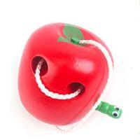 mois de jouets pour bébé en bois achat en gros de-Mange la pomme jouets en bois bébé 0-24 mois précoce enfants éducatifs avec la couleur rouge enfants jouet