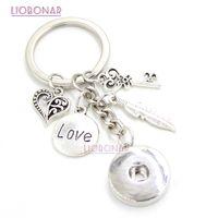 защелка с сумочкой оптовых-10PCS Wholesale DIY 18mm Snap Jewelry Snap Button Keychain Feather Love Key Chain Handbag Charm Key Ring Gifts Bijoux