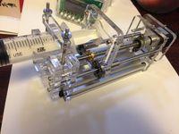 Injection pump, syringe propeller, laboratory micropump, glue dispenser