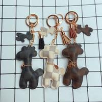 llaves de jirafa al por mayor-Nueva moda llavero accesorios borla llaveros PU cuero gato jirafa patrón coche bolso llaveros regalo de la joyería bolsa de accesorios del encanto