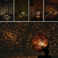 luzes giratórias venda por atacado-Luz da noite Girando Lâmpada Romântico Cosmos Belo Presente 3D Céu Projetor Star Master Crianças Estrelado Natal cor Amarela