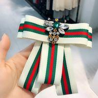 Wholesale brooch rhinestones - New Women Luxury Brand Stripe Crystal Brooch Bowtie Brand Designer Bee Rhinestone Suit Lapel Pin Collar Jewelry Accessories Gift