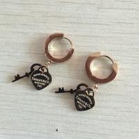 ingrosso orecchini orso inossidabile-Trasporto libero di goccia di alta qualità nessun orecchini dell'orso della perla dell'acciaio inossidabile di dissolvenza all'ingrosso per le donne che vendono i monili caldi di marca di modo