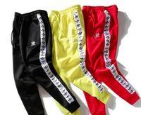 moda dizeleri toptan satış-Sonbahar ve kış guard pantolon Avrupa ve Amerikan moda kemer dize etiket baskı erkekler ve kadınlar pantolon rahat spor pantolon çift spo ...