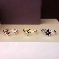открытие цветов оптовых-Новый stly Trend Марка 316L титана стали полые цветок трехцветный трехсекционный кольцо 18k золото открытие кольца Женские кольца