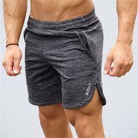 shorts de corrida masculinos venda por atacado-Mens ginásio calções de algodão correr esportes de corrida de fitness musculação Sweatpants masculino treino profissão Crossfit calças curtas Marca