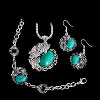 türkis schmuck set blume großhandel-Europa und die Vereinigten Staaten Türkis Schmetterling Blume Armband Halskette Ohrringe dreiteilige Set von schönen niedlichen weiblichen Schmuck