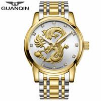 reloj diseñado chino al por mayor-GUANQIN Hombres Relojes Chinese Gold Dragon Brand Luxury Sculpture Reloj de cuarzo Hombres Moda Moda Relojes de pulsera impermeables Diseño