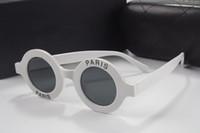 lunettes pour dames achat en gros de-Lunettes de soleil rondes de luxe pour femmes Designer Designer Revêtement Lunettes Paris Print 2018 Nouvelle Italie célèbre dames lunettes viennent avec la boîte