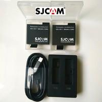wifi chargeurs d'expédition achat en gros de-Livraison Gratuite !! 100% D'origine SJCAM 900mAh Batterie Rechargeable Li-on Batterie et Chargeur et Etui Pour SJCAM M20 WiFi Sport Caméra
