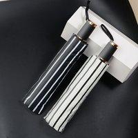 guarda-chuva chinês preto venda por atacado-Meninas chinesas triplo dobrável grosso sol de plástico preto sombreamento Guarda-sol listrado guarda-chuva de nove peças