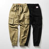 pantalones de chándal al por mayor-Pantalones de diseñador para hombre de Suprême EE. UU. Tendencia casual skateboard marca pantalones de chándal Múltiples bolsillos pie suelto pantalones de chándal calle hip hop nuevos mujeres pantalones cortos