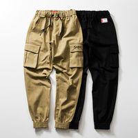 ingrosso pantaloni da skateboard uomo-Suprême mens pantaloni firmati USA tendenza casual pantaloni di marca di skateboard pantaloni multi-tasca piede sciolto pantaloni strada hip hop nuove donne pantaloncini