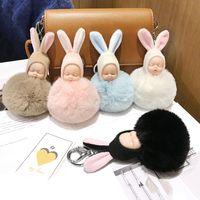 Wholesale baby boy girl pendant resale online - Colorful Sleeping Baby Doll Keychain Pompom Rabbit Fur Ball Key Chain Car Keyring Women Key Holder Bag Hanging Pendant Accessories