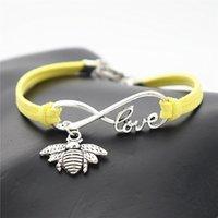 bracelets enroulés jaune achat en gros de-À La Main Tressé Jaune En Cuir Corde Wrap Charme Bracelet Bracelets De Mode Femmes Hommes Argent Infinity Amour Honeybee Mignon Abeille Bijoux Cadeau