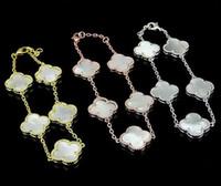 ingrosso braccialetto del trifoglio del fiore-Vendita calda quadrifoglio bianco e nero rosso verde polvere fiore conchiglia 5 fiori braccialetto d'oro 18 carati marea moda femminile bracciale