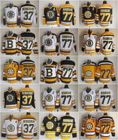 patrice bergeron schwarzes eis jersey großhandel-Herren 77 Ray Bourque Trikots Eishockey 37 Patrice Bergeron Boston Bruins Vintage-Trikot CCM 75. Schwarz Weiß Gelb