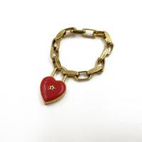 pulseras rojas para mujer al por mayor-Las pulseras del corazón rojo del cierre nuevas bijoux joyería gótica de la estrella mujeres del brazalete de metal de época Femme oro encantos de la cadena pulsera antigua