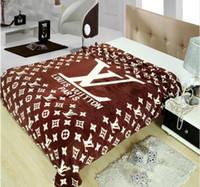 mantas de calidad al por mayor-Manta de franela de alta calidad CALIENTE 150 * 200 cm manta de marca de moda de primavera y verano manta cómoda sofá con aire acondicionado