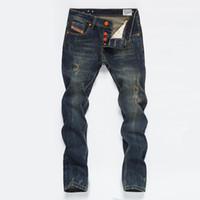 ropa vintage de diseñador al por mayor-Mens derecho Jeans Vintage botón del diseñador del bolsillo de pantalones para hombre Moda Distrressed Washed Jeans Masculino Adolescentes Ropa