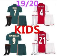uniformes de futbol gratis al por mayor-Nuevo 2019-2020 Ajax kids kit Soccer Jersey 19 20 Ajax de distancia Personalizado # 10 KLAASSEN # 34 NOURIB uniforme de fútbol de entrega gratis