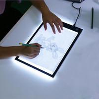 luces led en caja al por mayor-DHL regulable llevó gráfico de la tableta de escritura Pintura Dibujo regalo Caja de luz Tablero de trazado de copia Pad digital de la tableta Artesanía A4 Copia mesa LED