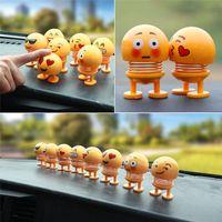 ingrosso i giocattoli che scuotono la testa-2019 Ornamenti per auto Divertente giocattolo a molla Accessori per interni Emoji Shaker Auto Decori Scuotere la testa bambola giocattolo decorazione auto