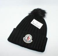 erkek kış şapkaları modası toptan satış-Lüks Kış marka KANADA erkekler bere Moda Tasarımcısı Kaput kadın Rahat örgü hip hop Gorros pom-pom kafatası kapaklar açık şapkalar