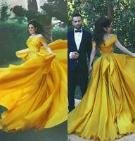 vestido de noche amarillento al por mayor-2019 Árabe Amarillo Vestidos de baile Beads Off The Shoulder Una línea Barato tren de barrido vestidos de noche más tamaño vestidos de Quinceañera