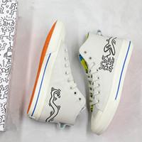 serpiente skate al por mayor-Cute Keith Haring x Originals Zapatos casuales Zapatos de skate de diseñador Hombres Mujeres Zapatillas de deporte divertidas de diseño de serpiente glotona