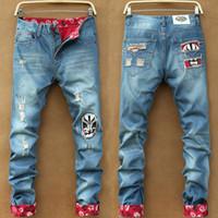 botones rosados agujeros al por mayor-Brand New Mens Jeans Moda Zipper desgastado de la cremallera Jeans para hombre Diseñador flaco Biker pantalones SKY Blue Hip Hop pantalones de mezclilla