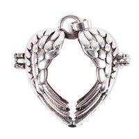 ingrosso fascino della gabbia della sfera-Wing Heart Silver Tone Hollowed Beads Ball Cage Pendant Angelo Caller Chime-Jewellery Ritrovamenti, Artigianato fai-da-te