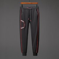 Wholesale tracking workouts online - Men Pants Long Sportswear Mens Fitness Workout Track Pants Skinny Sweatpants Trousers Joggers Casual Luxury Pants