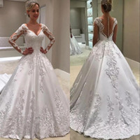 Wholesale wedding dresses v plus size online - Long Sleeve A Line Wedding Dresses Sheer Backless With Buttons Jewel Neck Appliques Long Vestidos Bridal Gowns