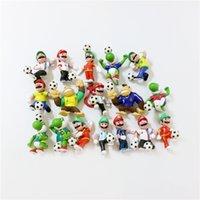 fußballspielzeug pvc großhandel-Super Mario Bro Figuren Puppe WM Mario Fußball Spielzeug Zufällig 7 CM Cartoon PVC Figuren Spielzeug Jede Puppe kommt mit Paket