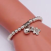ingrosso braccialetto del braccialetto dell'orso-Monili del braccialetto del pendente della campana dell'orso dei bambini del braccialetto di fascino della perla rotonda del bambino nuovi