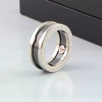 anéis de casais vermelhos venda por atacado-Casal para mulheres e homens clássico moda vender caridade pouco vermelho anel titanium aço bulgária amor anel de cerâmica dropshipping