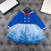 платье для девочки оптовых-Новые модели осень / зима 2019 для мальчиков и девочек в Европе и Америке. Морской воротник с бантом с длинными рукавами, пэчворк, сетка. Платье-наряд для родителей и детей.